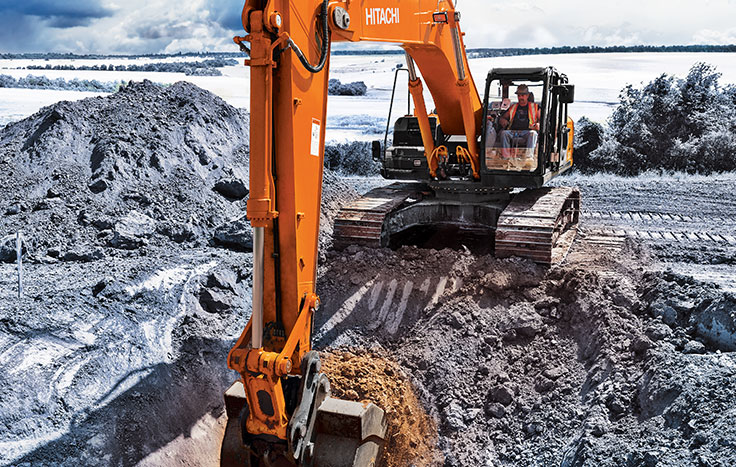 ZX380LC-6 Construction Excavator digging dirt with operator in cab