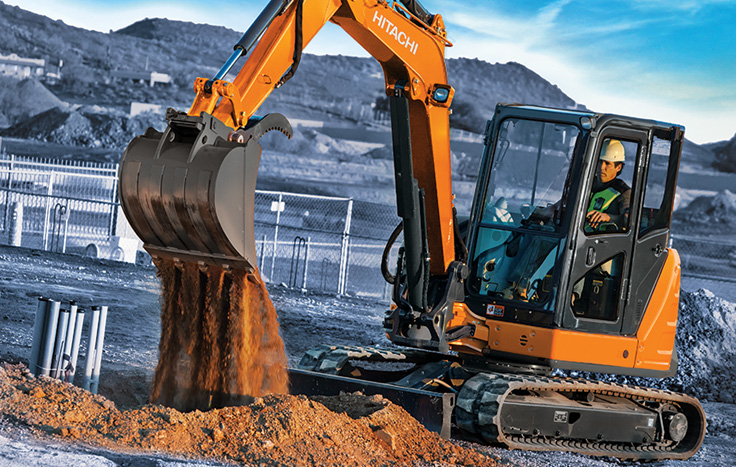 Hitachi ZX60USB-5 Compact Excavator with operator in cab