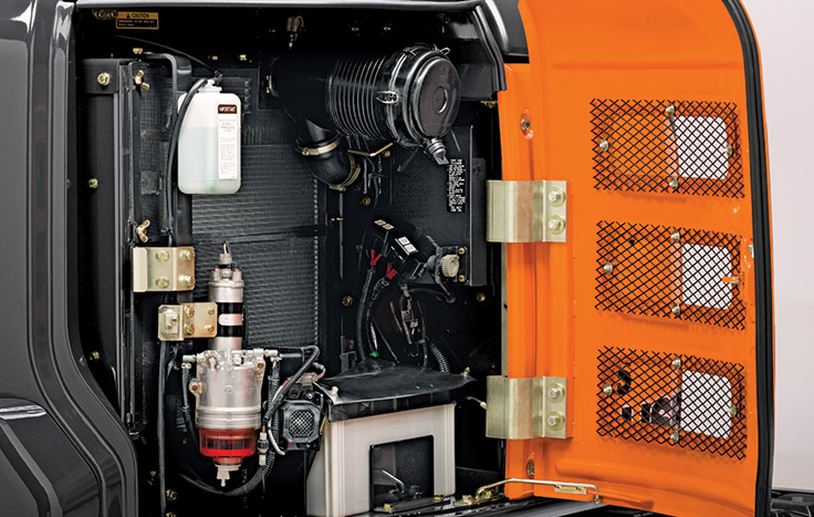 Hinged door provides easy access to the side-by-side oil cooler and radiator for easier core cleanout.