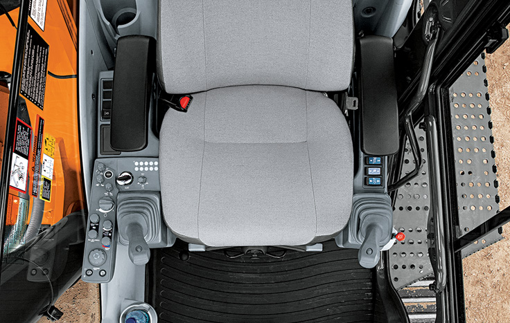Operators get maximum support from a sculpted mechanical suspension high-back seat.