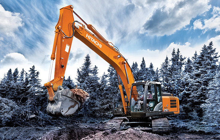 Hitachi ZX210-6 Utility Excavator digging next to forest