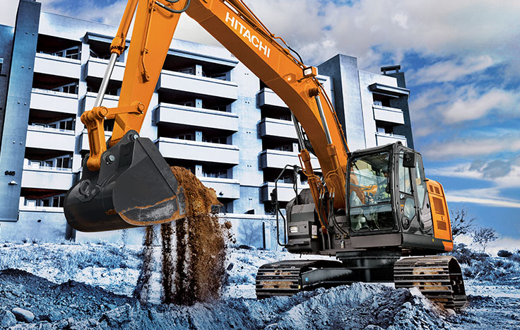 ZX245USLC-6 Excavator digging dirt outside of building