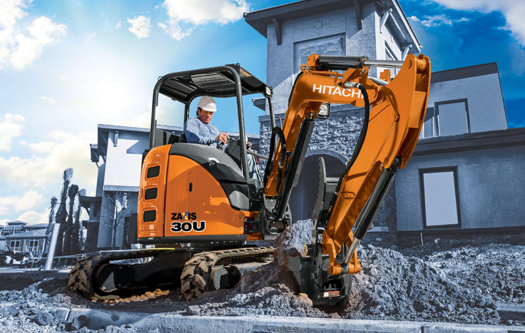 ZX30U-5, Compact Excavator with operator digging next to building