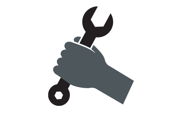 hand with a wrench
