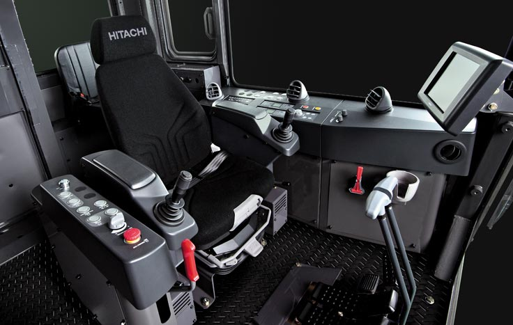 The automatic weight-adjusting air suspension seat determines the optimal cushioning effect to match the operator's weight.