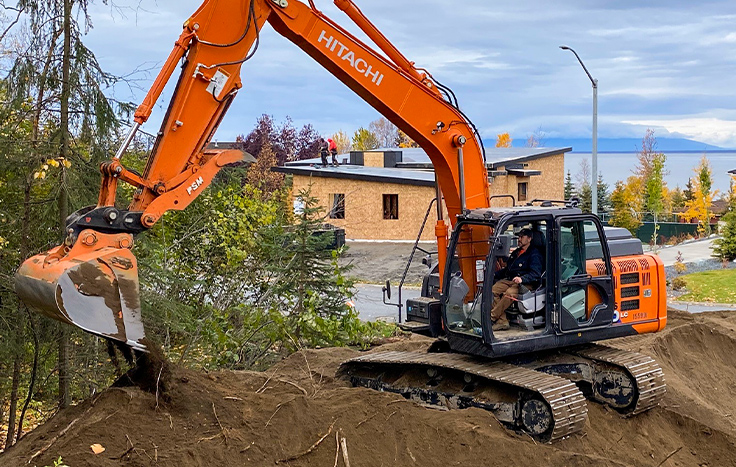 Hitachi ZX160LC-6 working on a home site